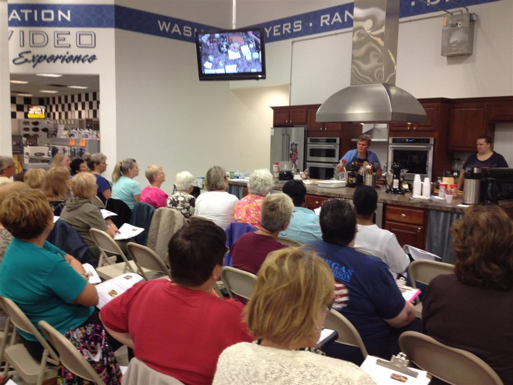 People attending cooking classes at ABC Warehouse.